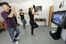 """French videogame company Ubisoft employees play a video game called """"Michael Jackson The Experience"""""""