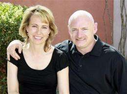 Giffords' astronaut husband decides to fly shuttle (AP)