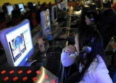 People surf the web at an internet cafe in Beijing