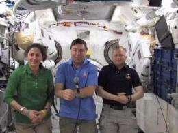 President Obama urges astronauts to unpack robot (AP)
