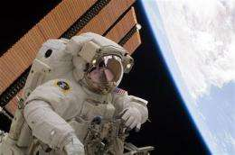 Astronauts remove troublesome cargo container (AP)