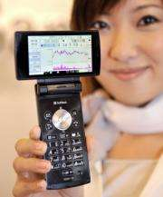 "A model displays a ""Stock mobile phone"" produced by Sharp"
