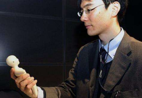 Japanese researchers developed a human-shaped mobile phone with a skin-like outer layer