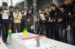South Korean spectators watching a robot performing