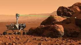 Mars Science Laboratory rover using ChemCam to analyze a rock