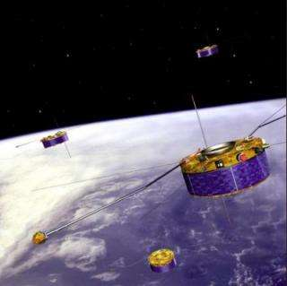 Artist's impression of the ESA Cluster mission, with four spacecraft flying in formation above Earth.