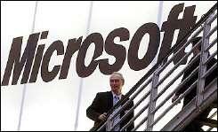 People walking past a giant Microsoft logo