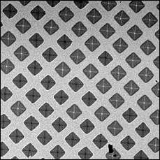 Pattern of magnetic squares showing two distinct polarities in black and white
