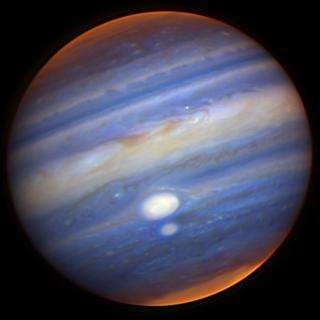 Gemini Captures Close Encounter of Jupiter's Red Spots
