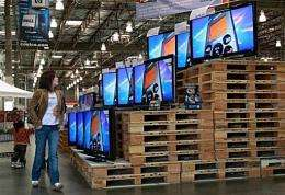 A customer looks at a display of televisions in San Francisco
