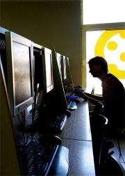 A man surfs the web at an internet cafe