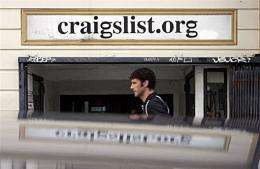 A man walks past the office of online site Craigslist in San Francisco