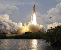 Astronauts inspect Atlantis while chasing Hubble (AP)