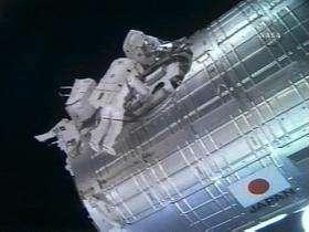Astronauts work on The International Space Station's Japanese Kibo module