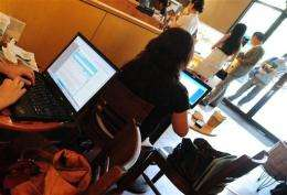 Customers use their laptop computers at a wireless cafe in Beijing