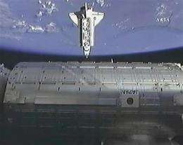 Space shuttle Endeavour arrives at space station (AP)