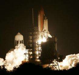 Space shuttle blasts off, finally flying on try 3 (AP)