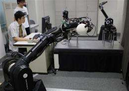 Japanese professor creates baseball-playing robots