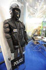 A display of police anti-riot outfit gear is shown at the Global Security Asia exhibition