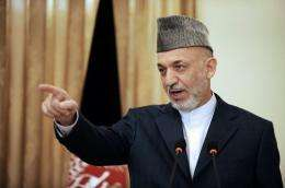 Afghan President Hamid Karzai calls on a reporter at a press conference
