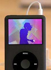 An Apple iPod plays an iPod commercial at an Apple Store in San Francisco