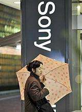 A pedestrian passes before a Sony showroom in Tokyo in 2008