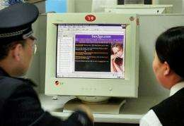 A policeman checks out a porn website at an Internet cafe in Beijing