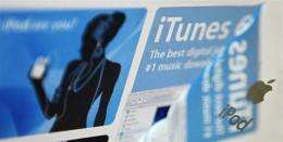 Apple's iTunes website is reflected in an iPod