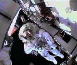 Astronauts cut spacewalk short due to suit trouble (AP)