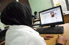 A woman using social networking website Facebook