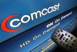 Comcast's 2Q profit soars 53 pct, tops estimates (AP)