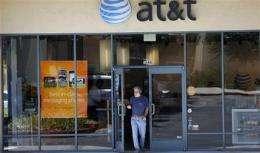 Economy and iPhone subsidies trim AT&T's 2Q profit (AP)