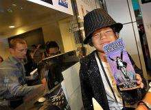 """Five-year-old Victor Chupina holds the first ticket sold for a special screening of Michael Jackson's """"This Is It"""""""