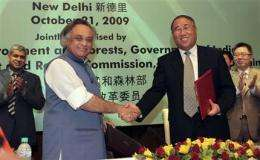 India, China agree to cooperate on climate change (AP)