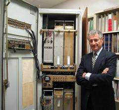 In this undated image scientist Leonard Kleinrock poses with the first Interface Message Processor