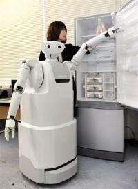 Japan's electronics giant Toshiba introduces their prototype housekeeping robot
