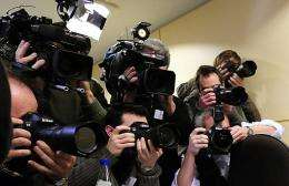 Journalists take their place at a press conference