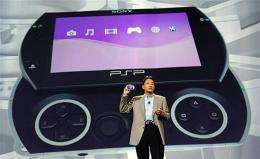 Kazuo Hirai, Chairman and Group CEO of Sony Computer Entertainment, Inc., displays the new Sony PSP Go