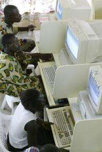 Locals surf the internet at a cybercafe in Bouake