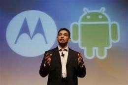 Motorola's shares surge with unexpected profit (AP)