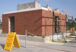 One-story masonry building survives strong jolts during seismic tests