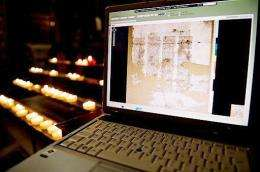 Pages of the Codex Sinaiticus are pictured on a laptop in Westminster Cathedral, central London