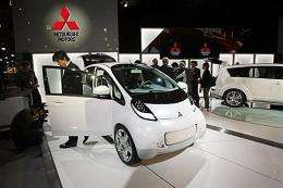 People inspect the Mitsubishi i-MiEv, a new electric microcar