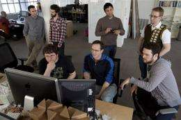 Personnel work at Twitter headquarters in San Francisco, California, pictured in March