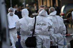 Police forensic team is seen at a recent scene of shooting in a western German town
