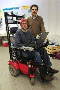 Professor Matteo Matteucci (R) and Ph.d student Bernardo Dal Seno (C), wearing a skullcap mounted with electrodes