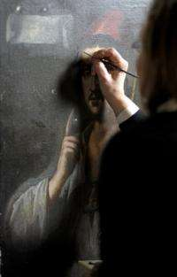 Recent picture of art study professor and specialist of Italian master Caravaggio, Roberta Lapucci, restoring a painting