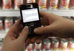 Shoppers with smart phones IQ squeezing retailers (AP)