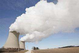 Steam billows from the cooling towers at a nuclear power generating station in Byron