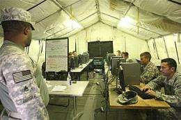 US soldiers spend their break browsing the internet at their base in Basra, Iraq